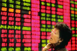 Uncertain times: A stock price monitor in Shanghai, China. The Shanghai index rebounded from the red to close higher by 0.7%. Eugene Hoshiko / AP