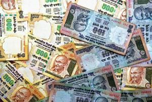 Recovery hurt: The rupee dropped as much as 0.6% to 48 a dollar, the weakest level since 28 May, before closing at 47.75 in Mumbai. Rajkumar / Mint