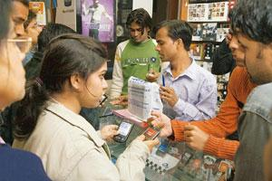 Commercial viability: People at a shop selling mobile phones. Union telecom minister A. Raja has said that the base price of 3G spectrum will be differentiated on the basis of telecom circles. Madhu K