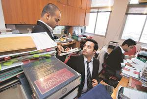 In demand: Lawyers at a firm in New Delhi. India is seen as a market where firms can generate more business than in Western economies. Madhu Kapparath / Mint