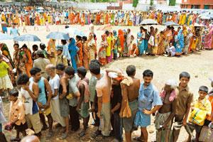Villagers stand in line to collect rations at a government distribution centre in Lalgarh on Monday. Deshakalyan Chowdhury / AFP
