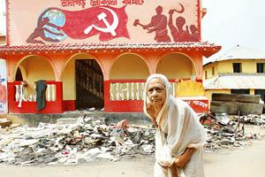 Target of attack: A woman walks past a CPM party office at Lalgarh. Jayanta Shaw / Reuters
