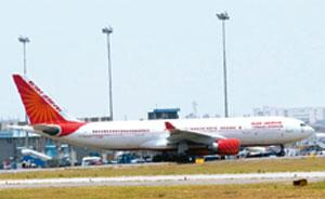 Seeking aid: An Air India aircraft at New Delhi airport. Air India has proposed cost-cutting measures, termination of aircraft leases, possible deferment of plane deliveries and restructuring of aircr