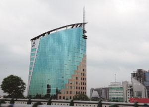Big catch: The DLF tower in Gurgaon. The cash-strapped realty firm sold its 66% stake in a private mill property in central Mumbai to an undisclosed Chennai-based investor for Rs310 crore in May. Rame