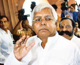 Looking back: Former railway minister Lalu Prasad arrives in Parliament to attend the presentation of the Railway Budget 2009 on Friday. Kamal Singh / PTI
