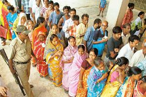Voters queue up to cast their votes at a polling station during the recent municipal elections in West Bengal. The CPM and its allies won only three of the 16 municipalities where elections were held.
