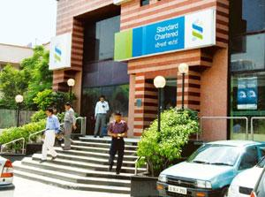 Path to profits: A Standard Chartered Bank branch at South Extension, New Delhi. The lender is in the process of revamping its consumer banking business in India as it looks to focus on affluent cust