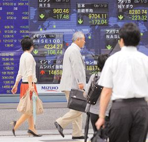 Stronger currency: An electronic share price board in Tokyo, Japan. The country's Nikkei index fell 0.3% as a stronger yen hit exporter shares. Kazuhiro Nogi / AFP