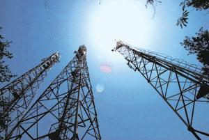 Reaching a deal: Airtel towers in New Delhi. Bharti had sought clarifications on takeover rules that require an acquirer of a 15% equity stake or more to make an open offer for an additional 20% from