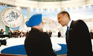 Time to talk: Prime Minister Manmohan Singh with US President Barack Obama at the G-8 summit in Italy on Thursday. Jason Reed / Reuters