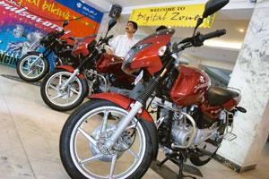 Strategy rethink: Bajaj motorcycles displayed at a showroom in Mumbai. The company had earlier decided to exit the 100cc segment. Prashanth Vishwanathan / Bloomberg