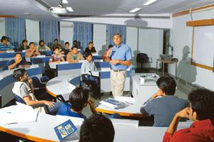 Tech-savvys: A file photo of a class being conducted in IIM Bangalore. The country's IIMs in April decided to tie up with Prometric of the US to convert their tests into a computer-based model in orde