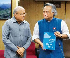New recommendations: Scientist M.S. Swaminathan and environment minister Jairam Ramesh with the report submitted by the expert committee on coastal management in New Delhi on Friday. Atul Yadav / PTI