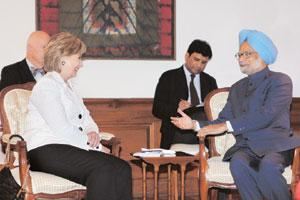 Better relations: Prime Minister Manmohan Singh with US secretary of state Hillary Clinton in New Delhi on Monday. Clinton invited Singh to the US in what would be the first state visit for the Obama