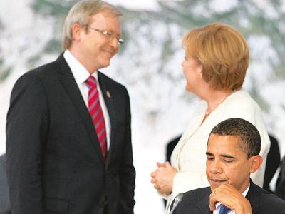 Ambitious plans: A 9 July photo of Australian Prime Minister Kevin Rudd (left), German Chancellor Angela Merkel (centre) and US President Barack Obama before the MEF discussion in Italy. Saul Loeb / A
