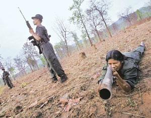 Security threat: A file photo of Naxalites training at a temporary base in a Chhattisgarh forest. The number of Naxalite attacks in the state increased from about 100 seven years ago to 624 last year.