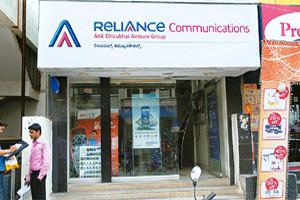 New agreement: A Reliance Communications store in Bangalore. Etisalat India has licences for 15 out of 22 telecom areas in India. It will use about 30,000 of RCom's 50,000 towers as it rolls out natio