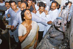 Speechless: Rita Joshi visits her house soon after it was torched by miscreants. AFP
