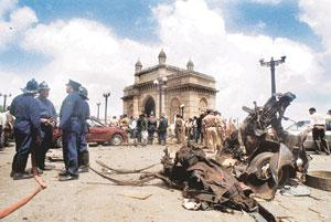 Gujarat revenge? A 25 August 2003 file picture shows Mumbai police and firemen conducting investigations at the site of a car bomb explosion at the Gateway of India. As many as 52 people died in the t