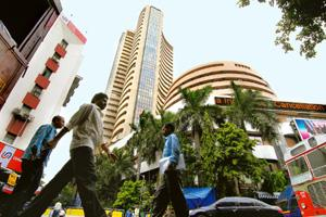 Better investment: The Bombay Stock Exchange building. While yields on debt instruments have been falling in the past six months, the 30-stock bellwether Sensex index has gained at least 49% since Apr