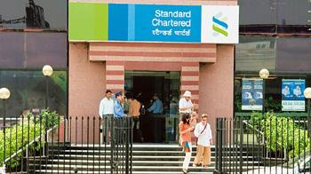 Bucking the trend: A Standard Chartered Bank branch in Delhi. The bank's loan book grew 12% last year. Madhu Kapparath / Mint