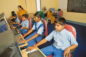Educating India: A file photo of a computer class in Shree Sharada Vidyalaya school at Amruth Nagar in Bangalore. The new initiative by some state governments would require installing computers with e
