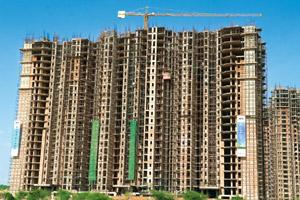 Dealing with debt: The DLF Park Palace construction site in Gurgaon. DLF reduced its debt by selling non-core assets and exiting projects with long gestation periods such as the Bidadi and Dankuni tow