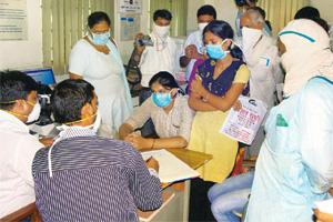 Pandemic: People at a hospital in Faridabad. Experts say more hospitals with adequate facilities are needed across the country. PTI