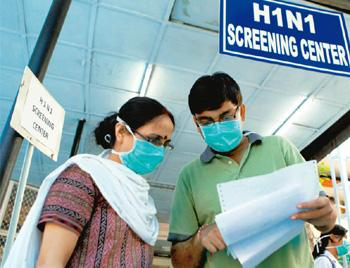 ER: Anxious patients and family outside a swine flu screening centre in New Delhi. Manvender Vashist / PTI