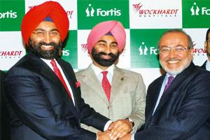 Expansion mode: (from left) Fortis chairman Malvinder Singh, managing director Shivinder Singh and Wockhardt chief Habil Khorakiwala during the announcement of the Fortis acquisition. Santosh Hirlekar