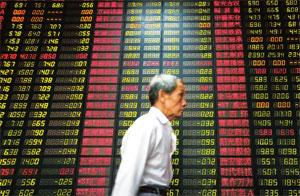 Market reacts: A stock price monitor in Shanghai, China. The Shanghai Composite index tumbled more than 5%, before halving those losses, after cautious remarks from Chinese Premier Wen Jiabao on Monda
