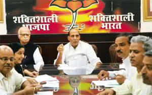 Leadership issues: BJP president Rajnath Singh (centre) and senior leader L.K. Advani (to Singh's right) at a meeting in Delhi on Saturday. The party is in the middle of a major ideological and organi