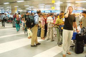 Extra burden: Passengers at the Indira Gandhi International Airport that is operated by DIAL. The special levies were imposed to part-finance the cost of modernizing airports and raise funds for devel