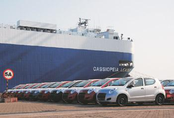 Gaining foothold: Maruti A-Star cars ready for export to Europe at the Mundra port. The firm aims to ship 130,000 cars in the year to March.