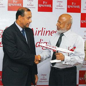 Unexpected move: A May photo of Siva Ramachandran (left) with Air Marshal Jamaluddin Ahmed of Biman Bangladesh Airlines at the launch of Kingfisher Airlines services connecting Dhaka and Kolkata.