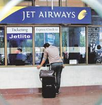 Trying times: A passenger at a deserted Jet Airways counter at the airport in Kolkata on Tuesday. Bikas Das/AP