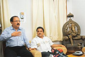Crisis talks: Congress MP Sanjay Nirupam (right) with Air India union leader George Abraham at a news press conference in New Delhi on Thursday. Nirupam has asked Jet to reinstate those who had been s