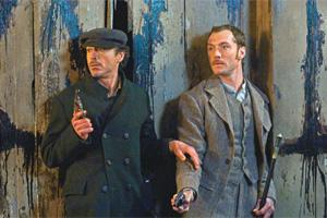 Intellectual action: Downey as Doyle's famous sleuth, with Law (right) as Dr Watson.