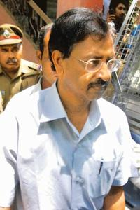 Under the scanner: A file photo of Satyam founder B. Ramalinga Raju coming out after a hearing at Nampally criminal court in Hyderabad. Bharath Sai / Mint.