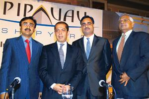 Equity offer: (L to R) Pipavav's Nikhil Gandhi, Atul Punj and; Jai Prakash Rai with Citigroup Financial's Ravi Kapoor in Mumbai on 10 September. PTI