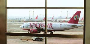 Feeling the drag: A file photo of a Kingfisher Airlines plane at Delhi airport. The airline has Rs6,000 crore of debt, almost a third of it coming from payments made to purchase new aircraft. Ramesh