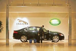 Driving ambition: A Jaguar Land Rover showroom in Mumbai. Respondents from the subcontinent had set themselves an average target of $9.07 million 'to achieve their life ambitions', outstripping every