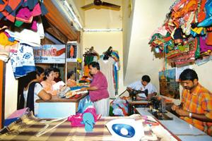 Scissor-hands: Chetan tailor at Commercial Street, Bangalore, can copy designs. Hemant Mishra / Mint
