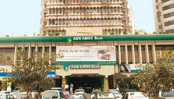 Battling losses: An ABN Amro branch in New Delhi. The bank has written off debt worth Rs962 crore this fiscal. Ramesh Pathania / Mint.