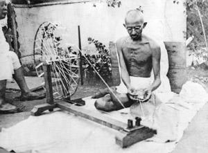 Symbol of self-reliance: Mahatma Gandhi working on a (spinning wheel). In 1924, Gandhi had said: 'What I object to is the craze for machinery, not machinery as such.' Dinodia