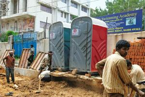 Filling a gap: Workers arrange portable toilets in Bangalore. Pune-based Saraplast has 600 portable toilets installed across India. Hemant Mishra / Mint