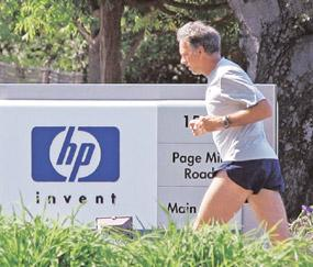 Sprawling portfolio: A file photo of Hewlett-Packard headquarters in Palo Alto, California. The firm has a formidable war chest of $13.7 billion in cash should it decide to acquire information technol