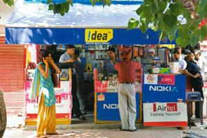 Attracting subscribers: A shop selling mobile phones and connections in New Delhi. Bharti Airtel chairman and joint managing director Manoj Kohli says tariff interventions will get traffic but not rev