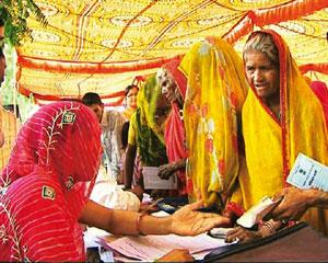 Curbing corruption: Women queue up with complaints in Baran village of Bhilwara district. As many as 12 FIRs have been filed in the district against government officials as a result of the audit. Ajit