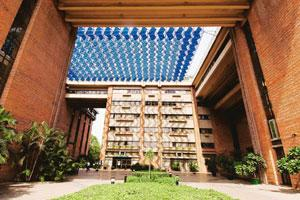 Stein's architecture for the India Habitat Centre, New Delhi, celebrated bricks as an elegant material, linking it to prestige. The cleverly designed pergola over the courtyard has angled panels that